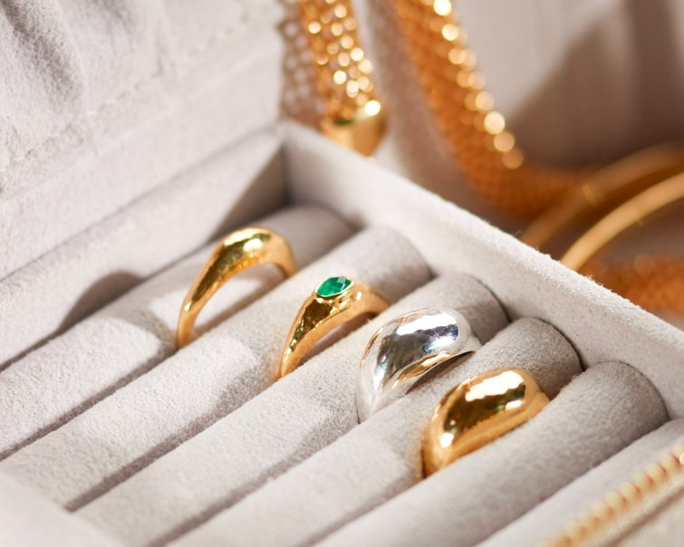 A selection of rings kept safe in a Monica Vinader jewellery box.