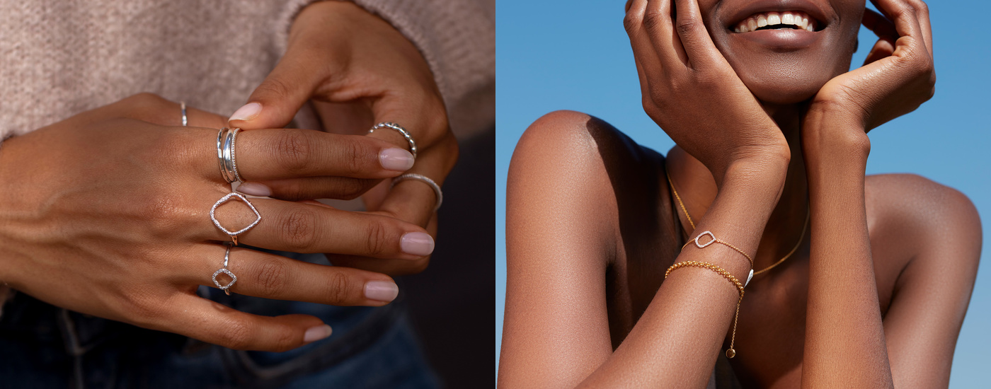 A model wearing a selection of silver rings including the Riva Kite Diamond Ring