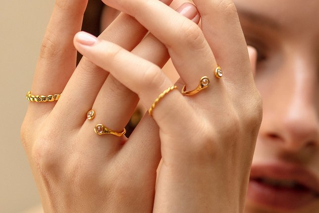 Model showcases a selection of gold vermeil stacking rings