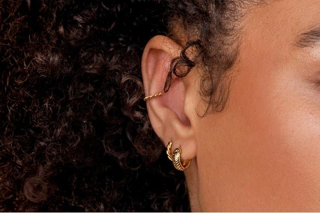 Model wearing Monica Vinader Gold Huggie Earrings