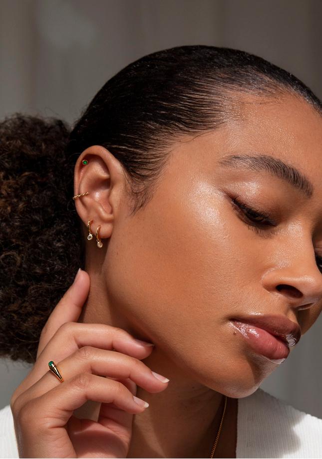 Model wearing Gemstone Huggie Earrings