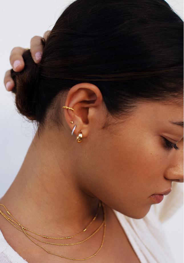 Model wearing mixed metal ear stack