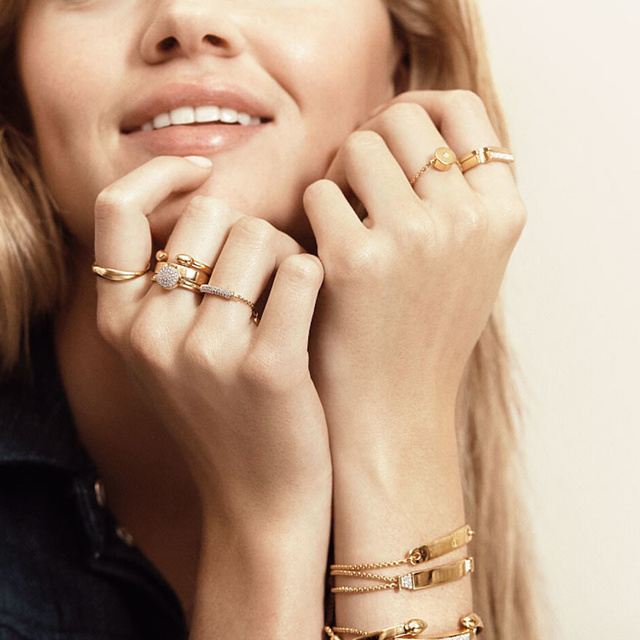 woman wearing several rings
