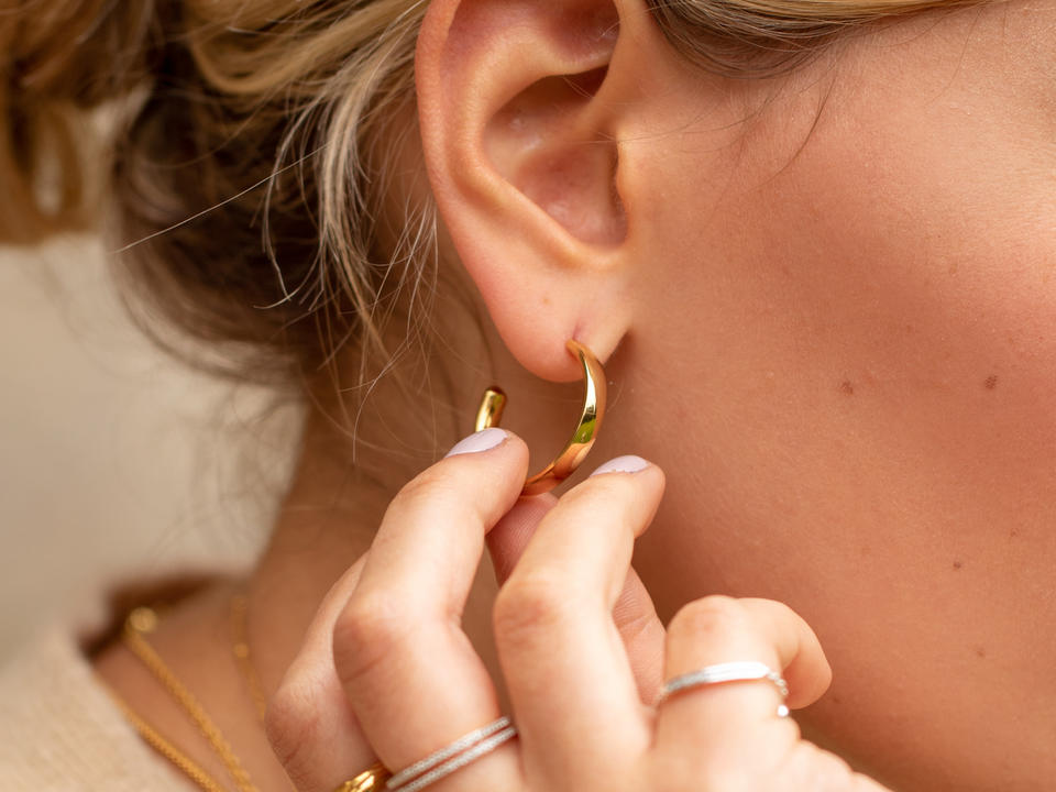 add large hoop earrings to accent your look