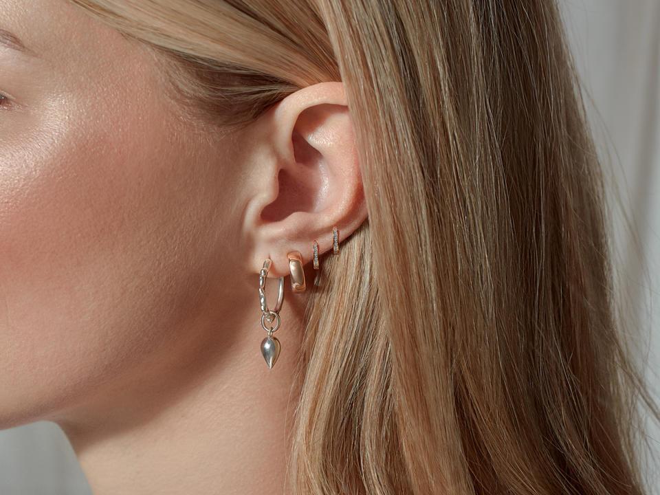 stackable earrings create a unique ear look