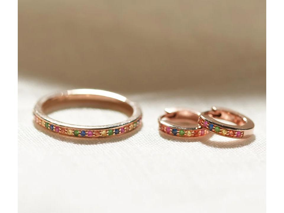 infinity rings can feature colourful gemstones