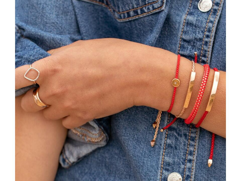 red bracelets can be made of thin cord which makes for perfect stacking bracelets
