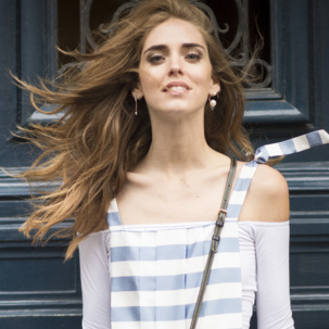 Chiara Ferragni wears Skinny bud earrings