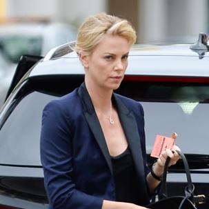 Charlize Theron wears Monica Vinader Alphabet pendant