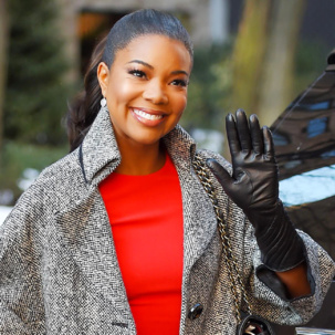 Gabrielle Union wears Monica Vinader Diva Lotus Drop Earrings in Diamond and Moonstone on The View in New York City.