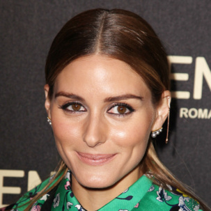 Olivia Palermo works the one earring trend at the Fendi Flagship store opening in New York with the Monica Vinader Skinny Bud Long Diamond Bar Earring.