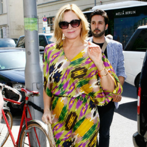 Kim Catrall wears Monica Vinader Fiji Bracelets with Plum and Saffron cord whilst out in Berlin, July 2012.
