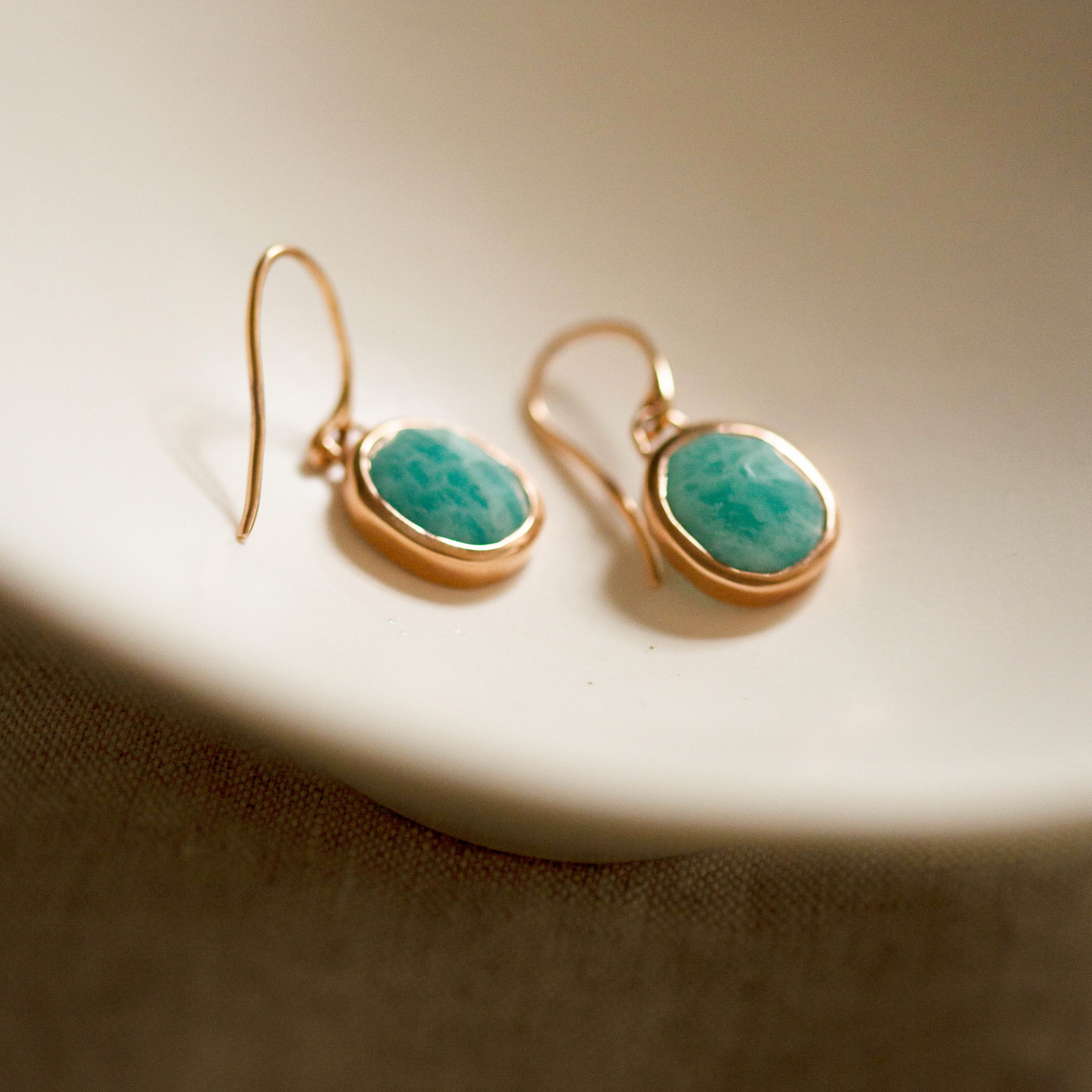 Earrings with gold on silver pendants with a gold-plated oval and Amazonite