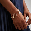 Woman wearing Rose Gold Alta Capture Charm Bracelet with pendant charms