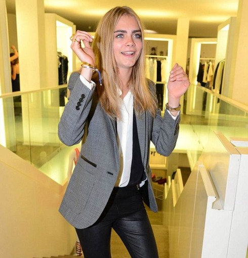 Cara Delevingne wears Monica Vinader Siren Thin Cuff and Fiji Friendship bracelet at the Taken By Storm exhibition in London, April 2013.