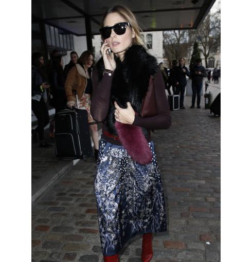 Olivia Palermo wears Monica Vinader Ava Diamond Pave and Riva Diamond Hoop bracelets at London Fashion Week 2014.